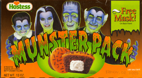 Munster Pack frosted chocolate cakes with creamy filling and free mask