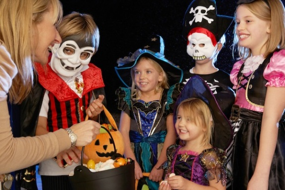 happy halloween party with children trick or treating - What Is Halloween A Celebration Of